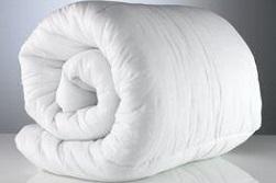Jak dopasować kołdrę do łóżka?